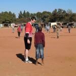 Coaching soccer in an informal settlement outside Pretoria
